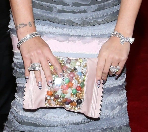 Lily Allen chose a quirky candy clutch to offset her glam look