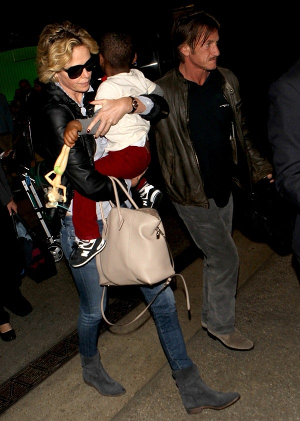 Charlize Theron with Sean Penn and son Jackson at the Los Angeles International Airport on May 30, 2014