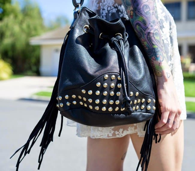 Brittany's studded and fringed bucket bag
