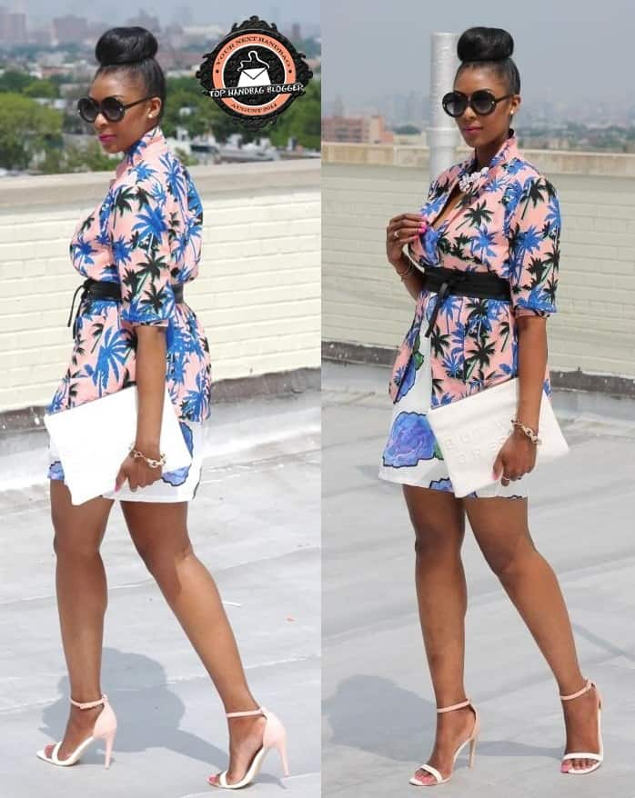 Marsha Campbell flaunts her legs in a palm print dress