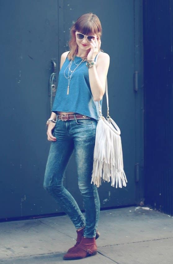 Veronica rocks blue jeans and a white fringe bag