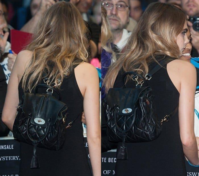 Cara Delevingne showing off her Mulberry Cara Delevingne bag
