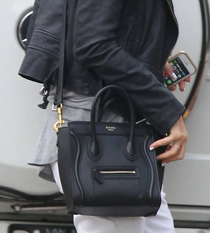 Ashley Tisdale carries a black Celine Nano crossbody bag