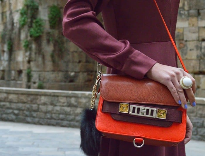 Isabelle carries a colorblock purse from Proenza Schouler's signature PS11 family