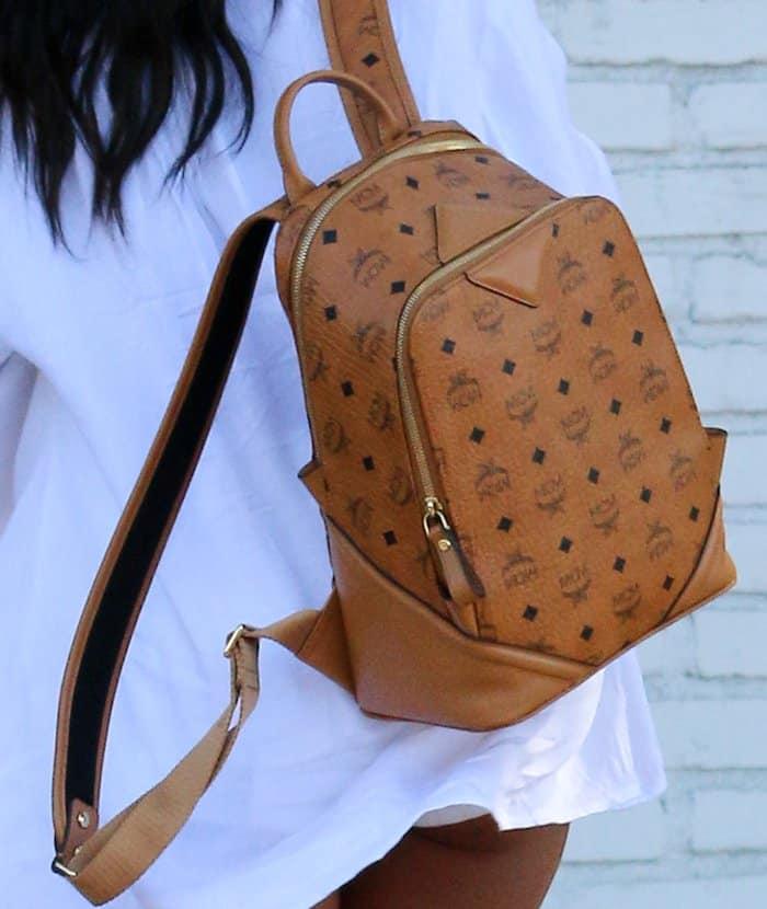 Karrueche Tran toting a tan MCM backpack