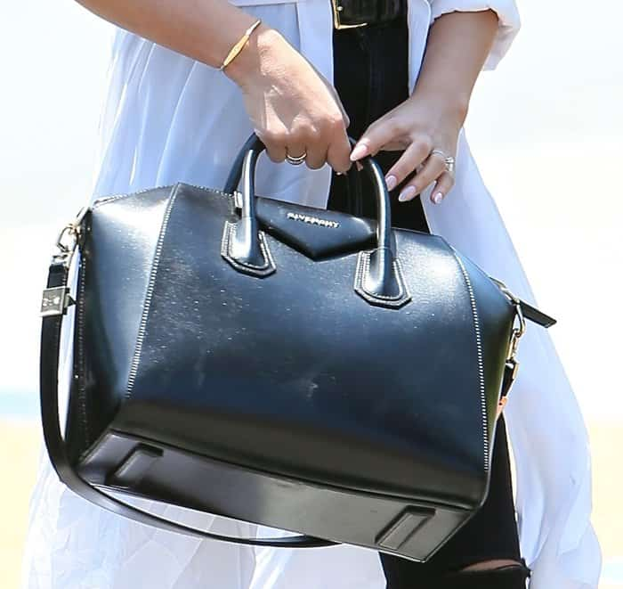 Chrissy Teigen carrying an expensive Givenchy leather handbag