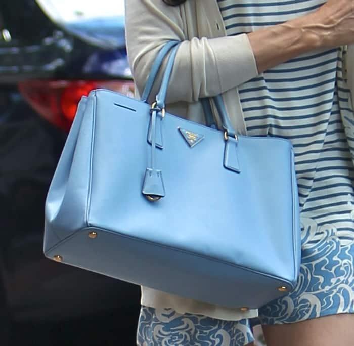 Famke Janssen carrying Prada's Saffiano Lux tote