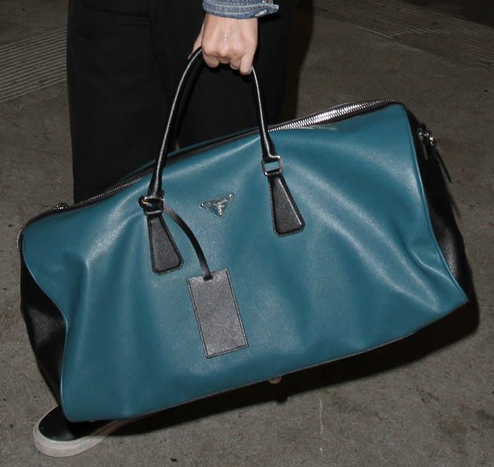 f6be9b4f91e86d ... official store kate mara carrying pradas duffel bag f9a69 e8bda