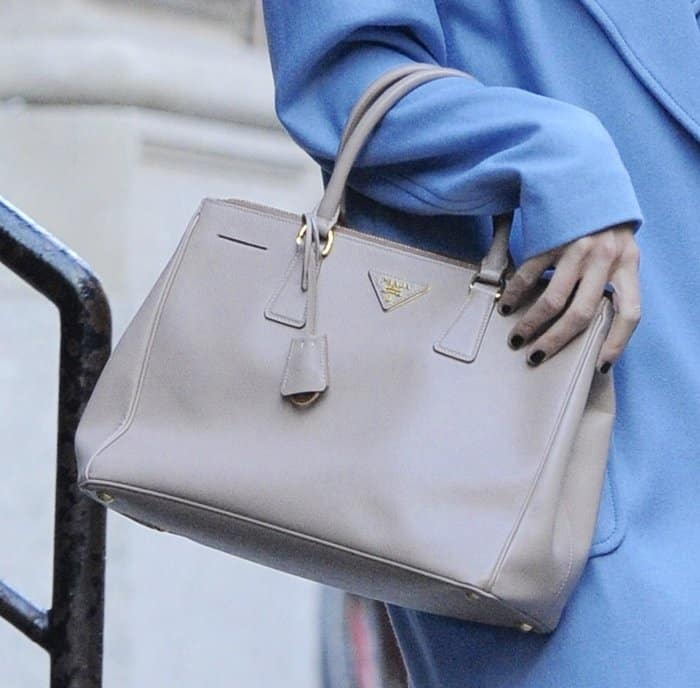 Taylor Swift carrying Prada's Saffiano Lux tote