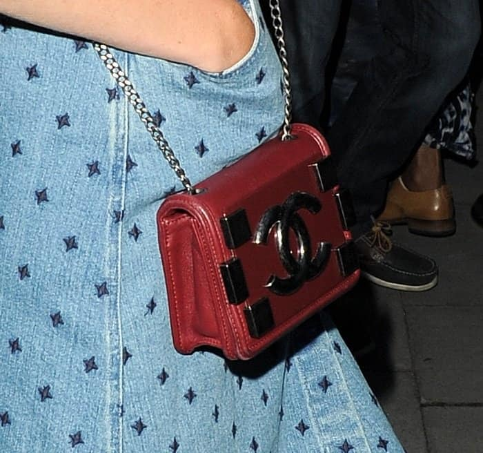 Poppy Delevingne toting an adorably gorgeous mini Chanel purse in deep red