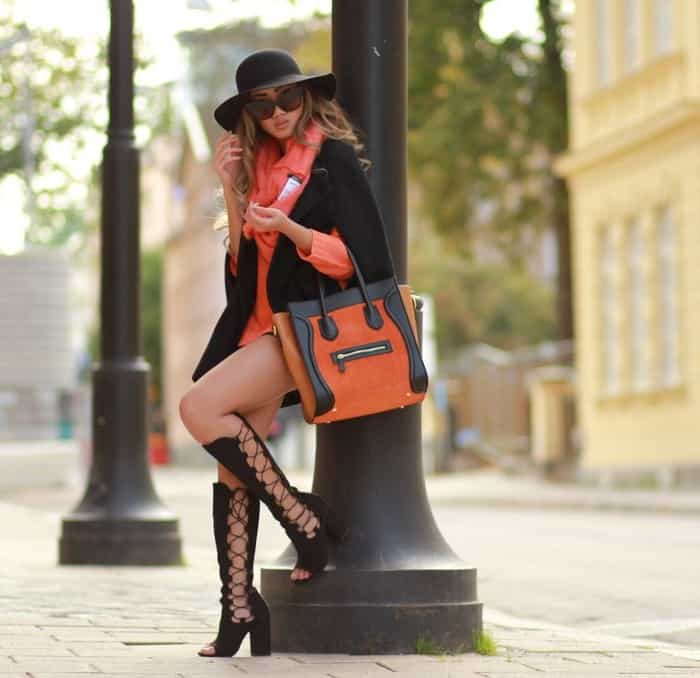 Louise Xin with her orange-and-black purse from Massimo Castelli