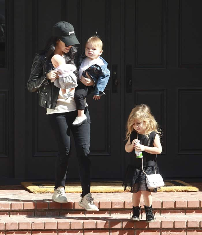 Kourtney Kardashian with Penelope Disick and Reign Disick on the way to singing class on February 18, 2016