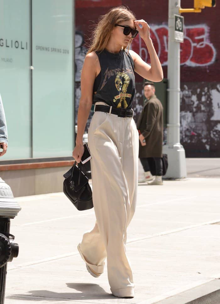 5e1af1ef26 Gigi Hadid Carries Versace Palazzo Empire Bag in SoHo