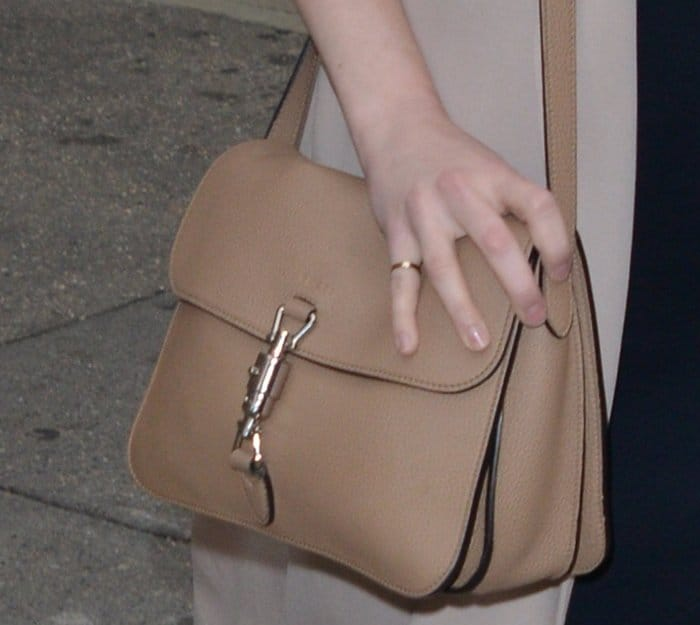 Emma Stone's nude Gucci Jackie soft leather flap shoulder bag