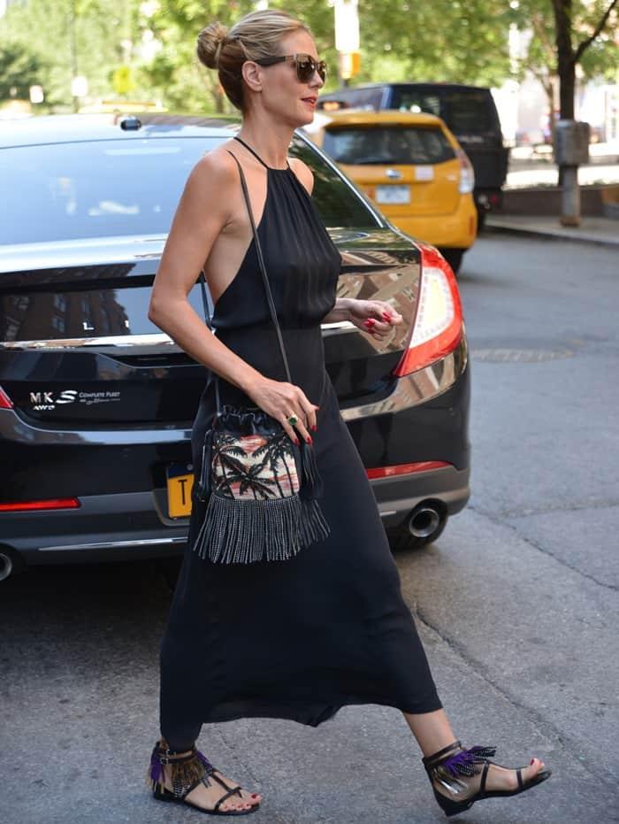Heidi Klum rocks a black silk Nili Lotan maxi dress in Tribeca