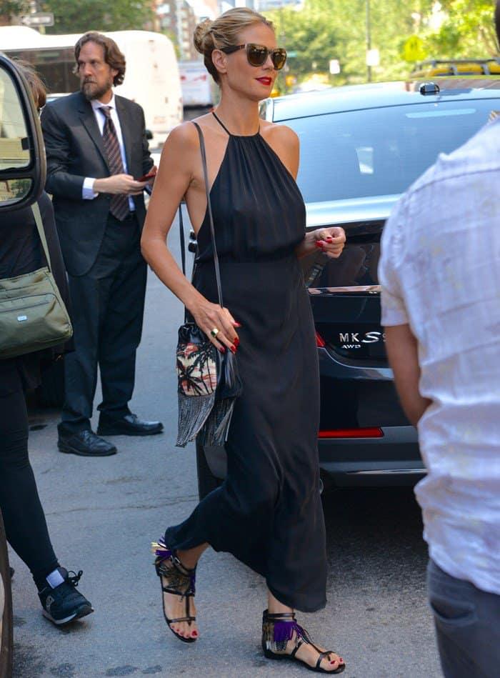 Heidi Klum's long dress looks refined, yet subtly sexy