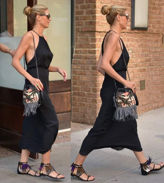 Saint Laurent completed her look with Nu Pieds multi-fringe sandals