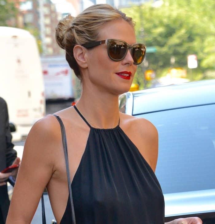 Heidi Klum went braless with oversized sunglasses