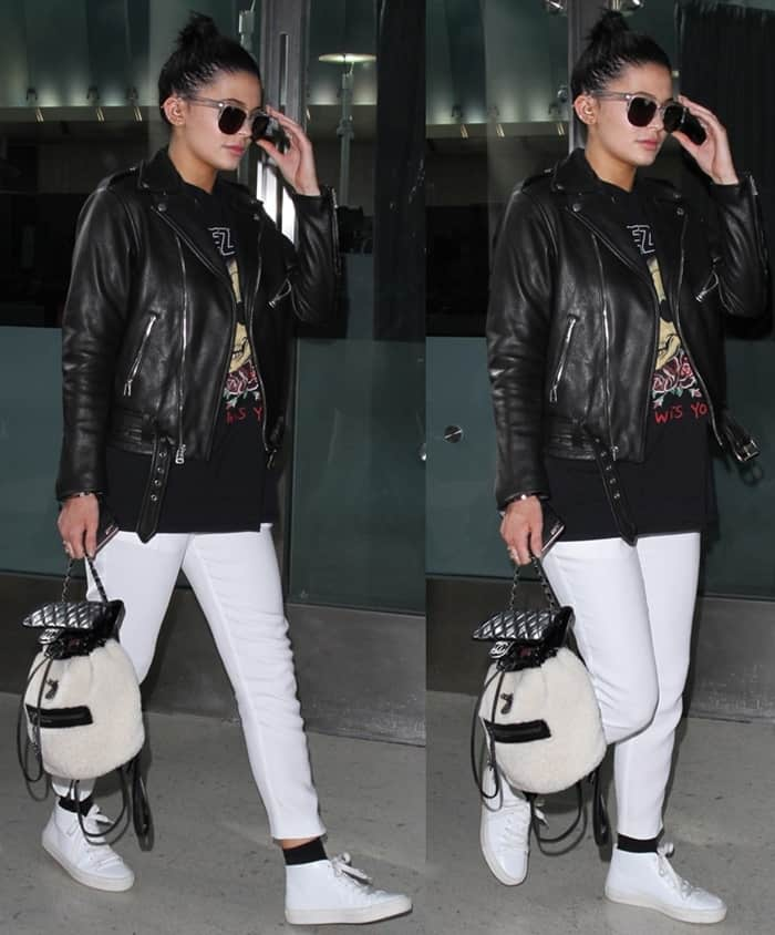 c0eaec277038b6 Kylie Jenner arrives at Los Angeles International Airport on December 7,  2015