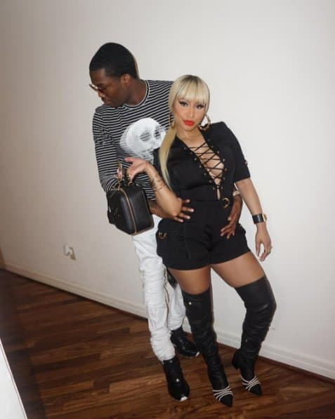 Nicki Minaj does a couple shot with beau Meek Mill and her Chanel bag on June 6, 2016