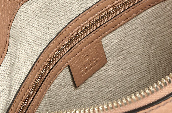 Look for a heat stamp or label stitched on the interior
