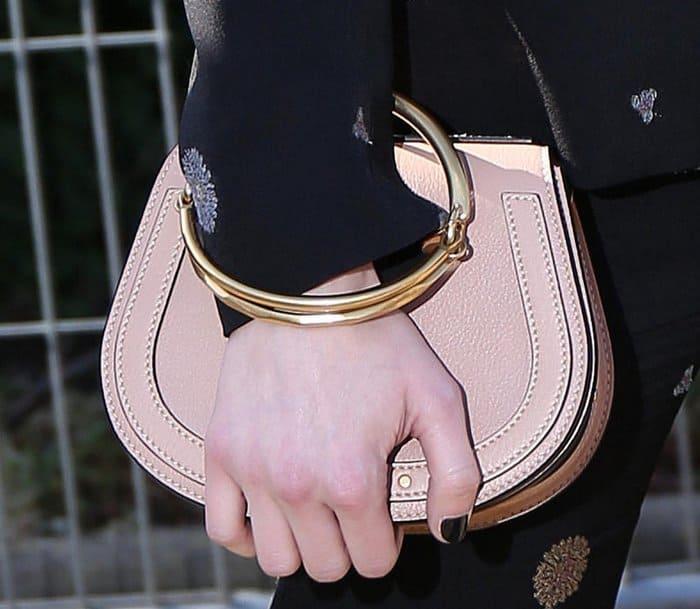 Emma Watson carrying a Chloe Nile Medium purse during fashion week.