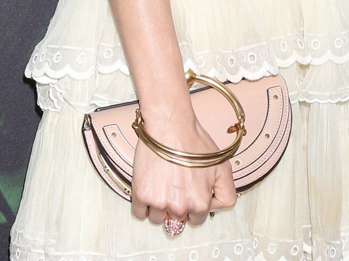 "Sienna Miller carrying a Chloe ""Nile"" Minaudiere purse."