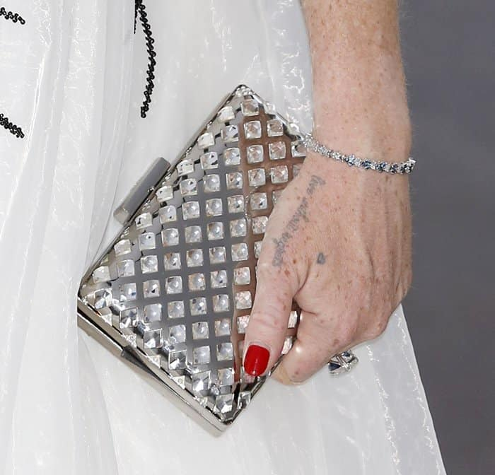 The glitzy clutch was paired with sparkling diamond jewelry
