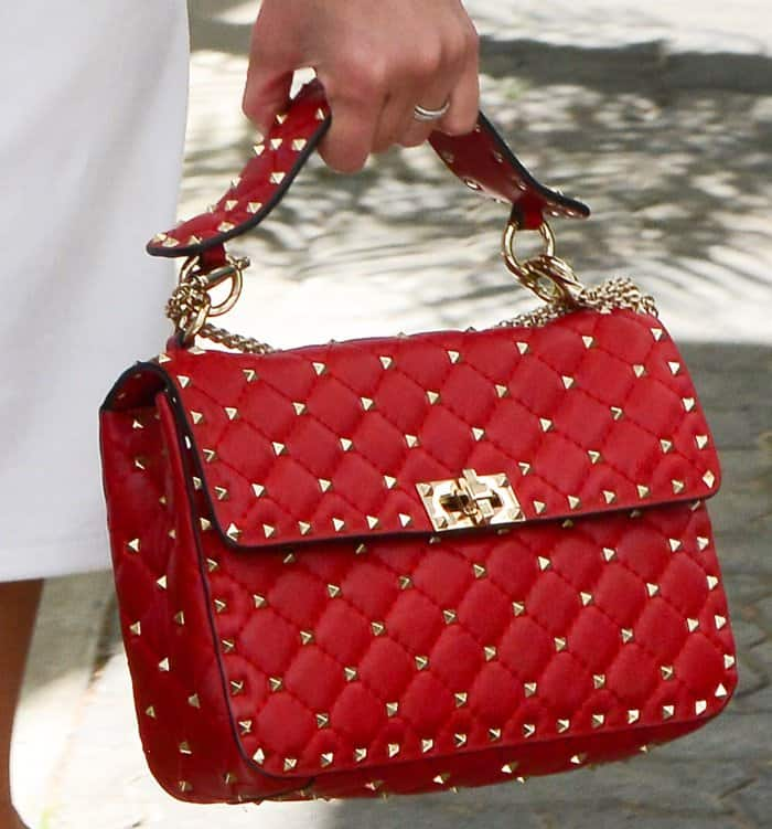 Pyramid gold studs decorate this gorgeous quilted leather bag