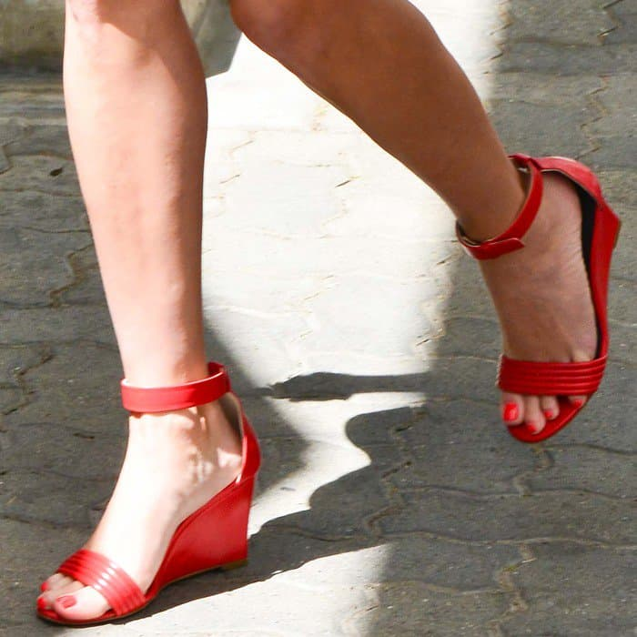 Reese Witherspoon wearing red wedge sandals