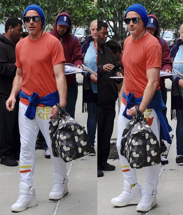Robert Downey Jr. wore a blue beanie, an orange shirt, white sweatpants and white hi-top rubber shoes
