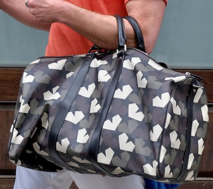 Robert signed autographs for his fans while carrying a Ports 1961 camouflage bag