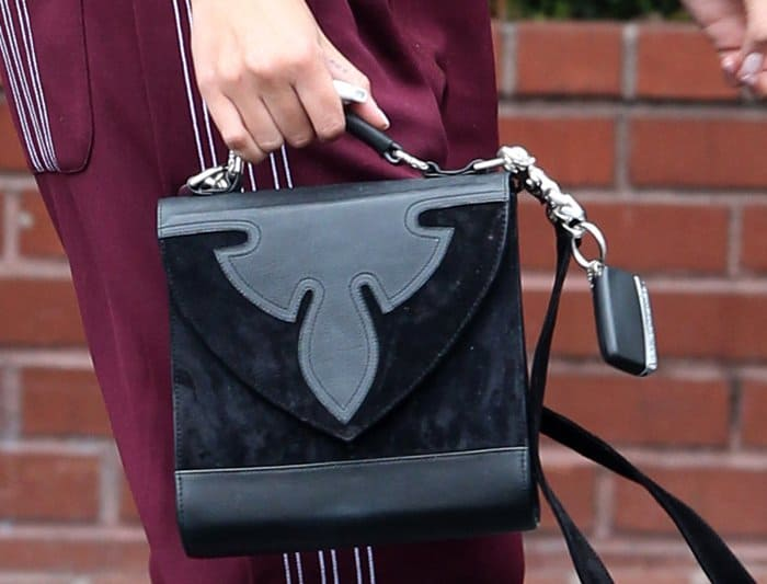 The Chrome Hearts Nataya bag features a beautiful mix of suede and leather, with a flap front closing