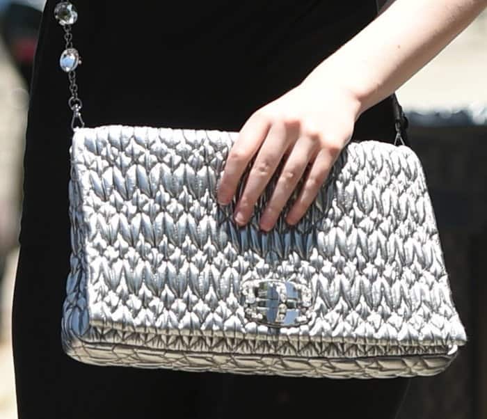 Elle Fanning's Miu Miu bag features gorgeous ruching on its leather and a crystal-embellished turnlock