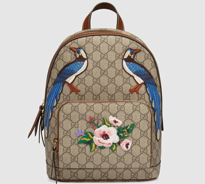 The Gucci Garden The Souvenir Collection Backpack is decorated with lovely blue birds and a flower on its zip pocket.