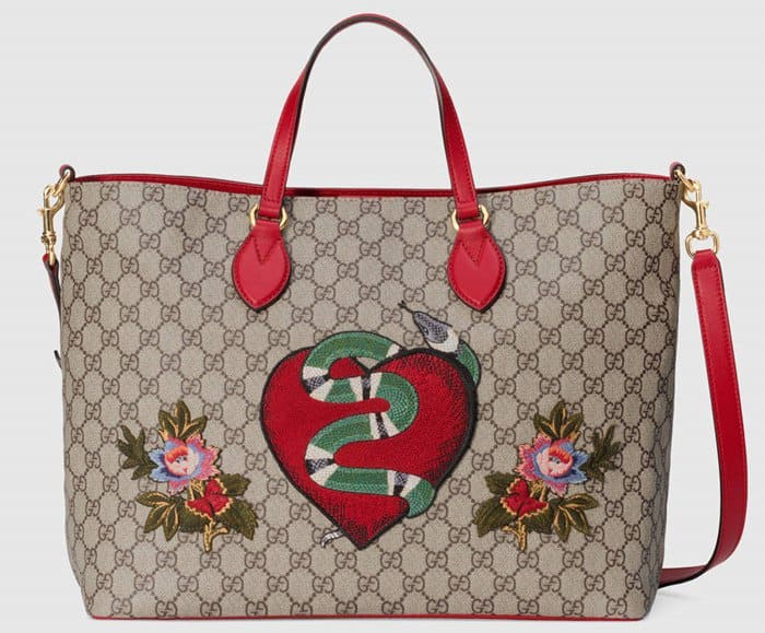 The Gucci Limited Edition soft GG Supreme tote features a snake and flowers design.