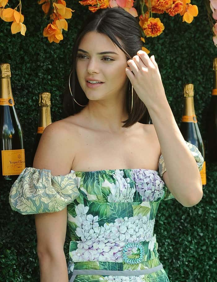 Kendall accessorized her floral look with large golden hoop earrings