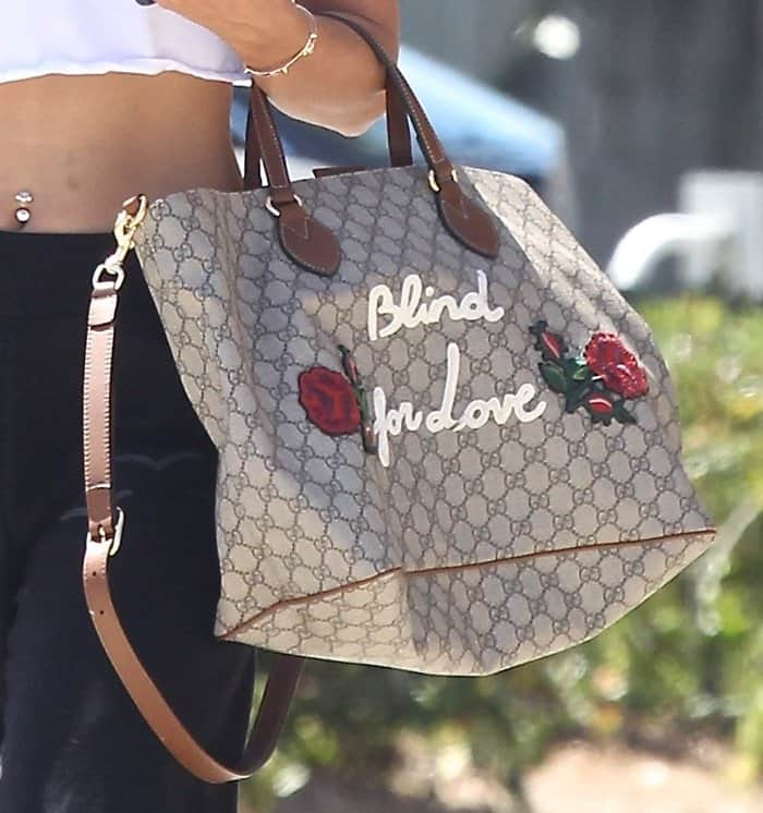 Vanessa Hudgens monogram Gucci tote is a standout piece with its added embellishments.