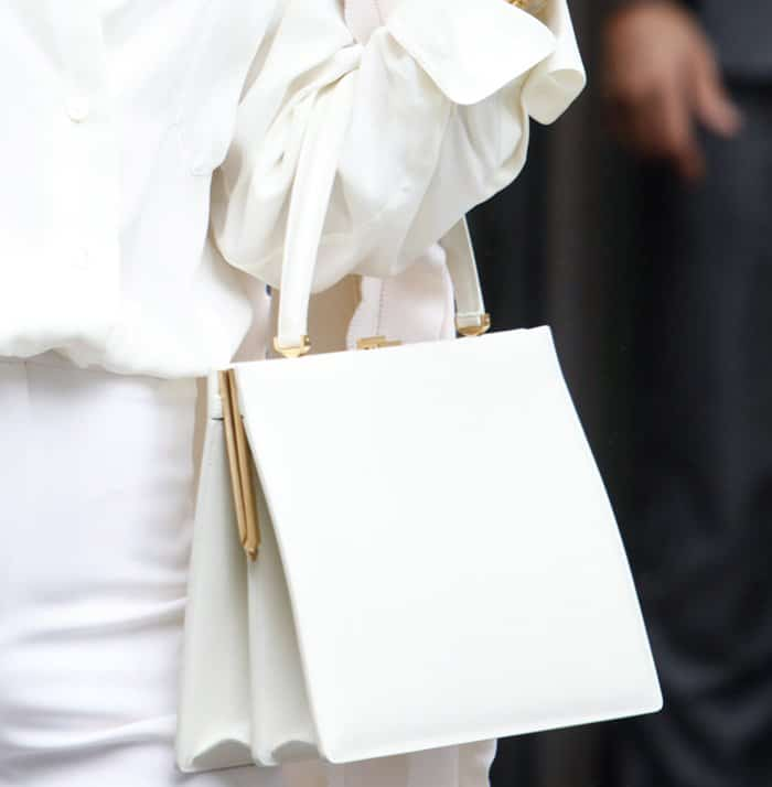 The Celine Medium Clasp Tote features a structured, polished design.