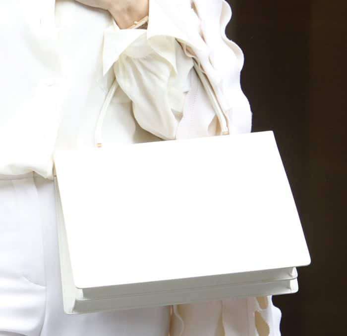 Celine Dion carrying a Celine Medium Clasp Tote at Paris Fashion Week.
