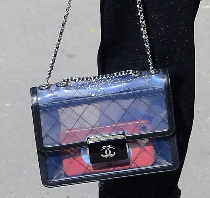 Claudua Schiffer carrying a see-through Chanel purse during Paris Fashion Week.