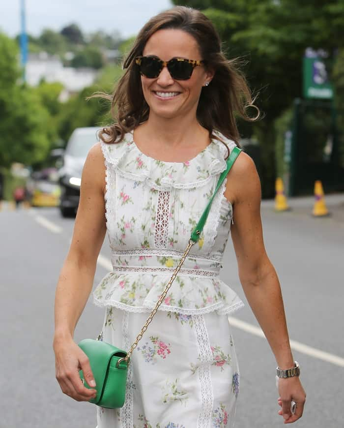 Pippa attended Wimbledon in a floral ensemble styles with a green crossbody purse.