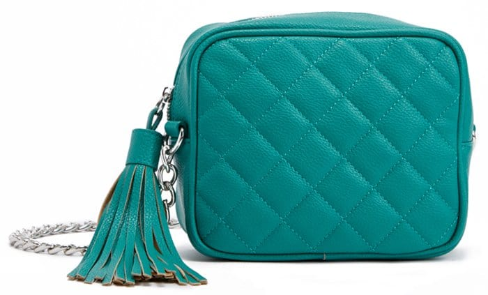 Green quilted crossbody bag with a tasseled zip-around closure and chain-drop shoulder strap