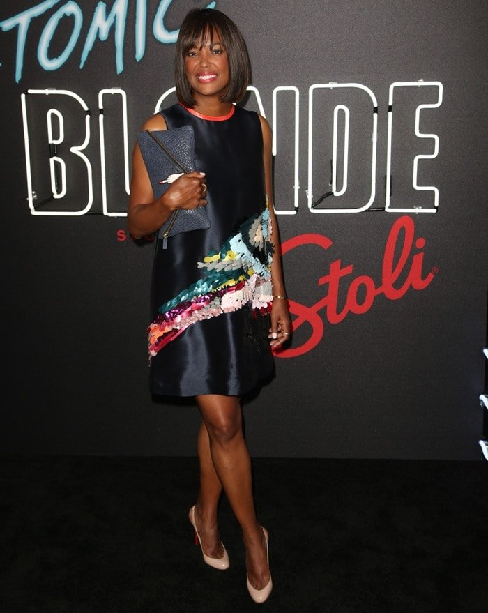 Aisha Tyler wore a satin shift dress that featured an eye-catching appliqué detail
