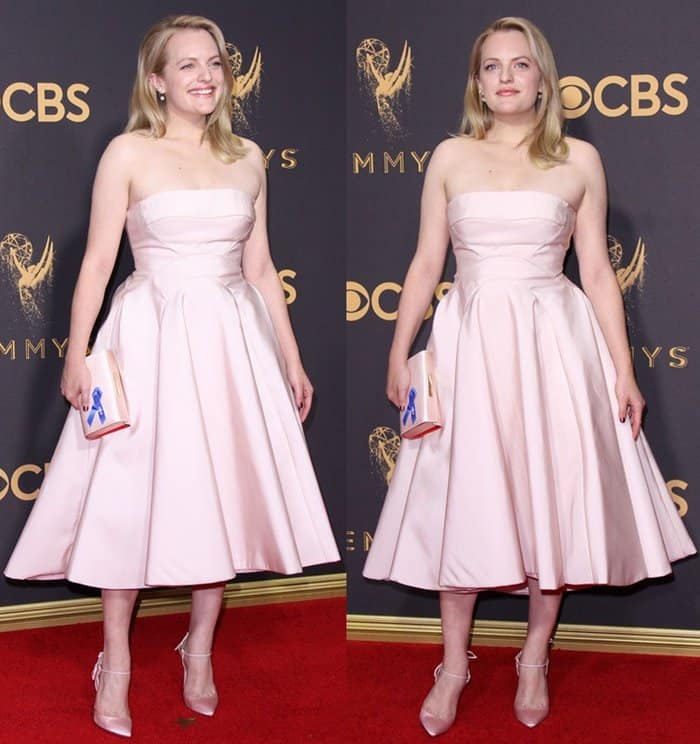Elisabeth Moss wearing a pink gown on the 69th Emmy Awards red carpet.