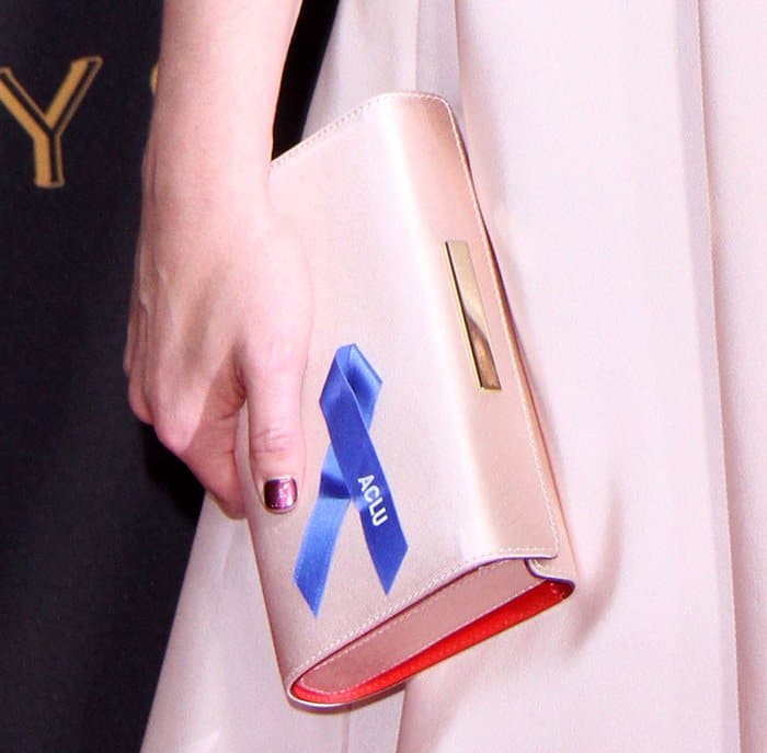 Elisabeth Moss carrying a special clutch at the Emmy Awards.
