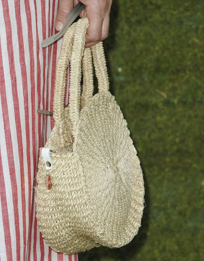 Kate Hudson carries a straw bag at the 8th Annual Veuve Clicquot Polo Classic at Will Rogers State Historic Park.