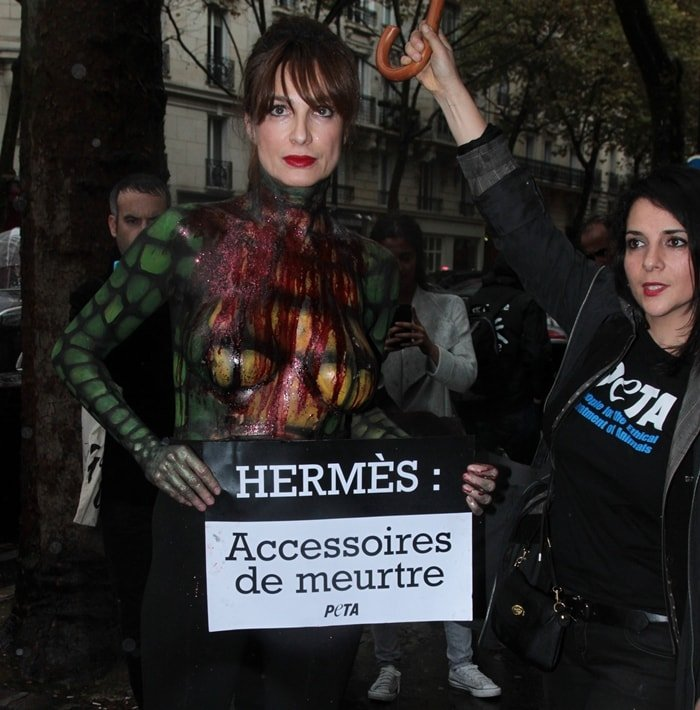 Animal rights organization Peta and German actress Alexandra Kamp protesting against the use of crocodile skin outside the Hermes fashion show in Paris, France