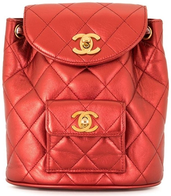 This backpack from Chanel comes in sleek red leather and fastens with an interlocking CC twist lock