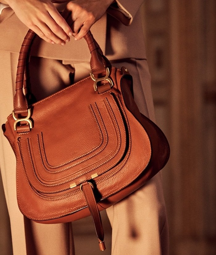 Chloé's iconic Marcie round saddle mini bag in small grain calfskin